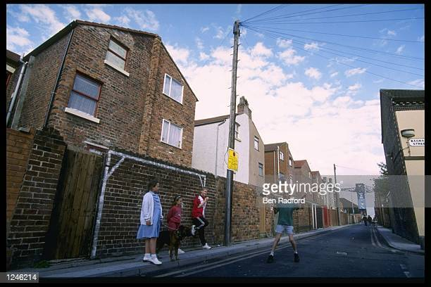 Children in Liverpool practice their soccer skills in the streets during the European soccer championships at Anfield Liverpool Mandatory CreditBen...
