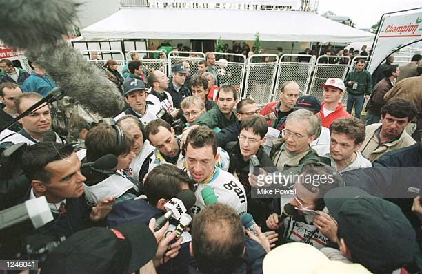 Chris Boardman of Britain talks to the press after finishing second in the Prologue around the town of 'sHertogenbosch in Holland at the start of the...