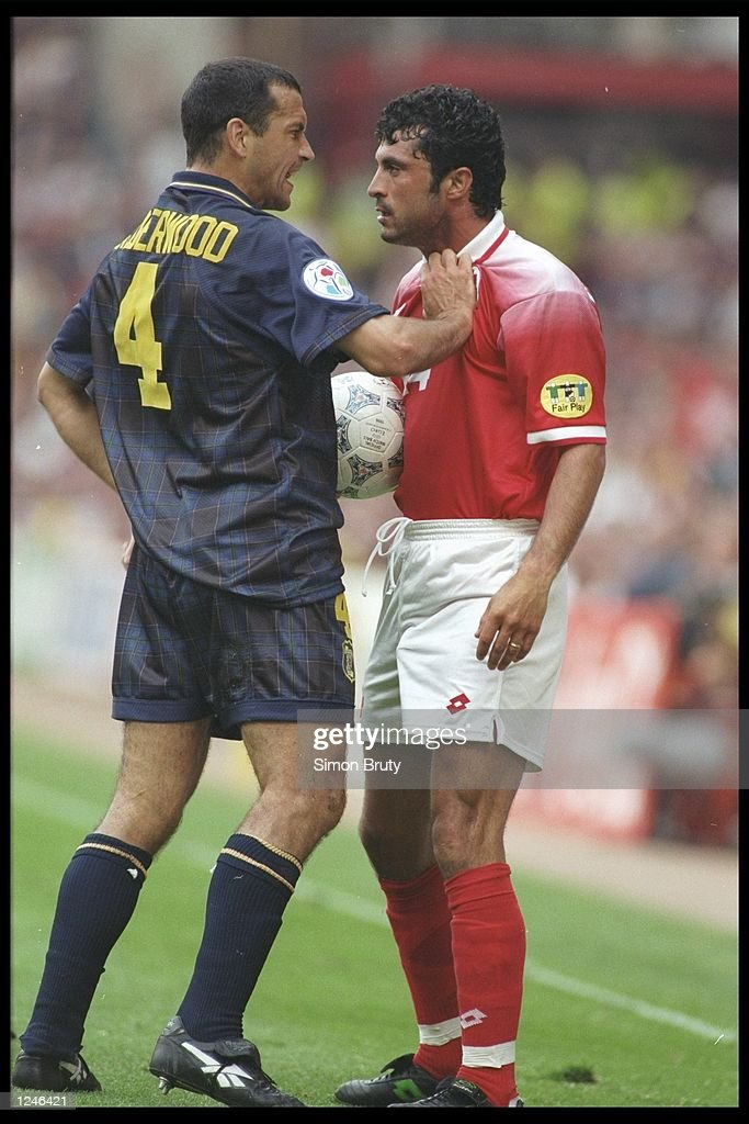 Colin Calderwood of Scotland argues with Kubilay Turkyilmaz of Switzerland during the Group A match at Villa Park in the European Football Championships. Scotland beat Switzerland 1-0.