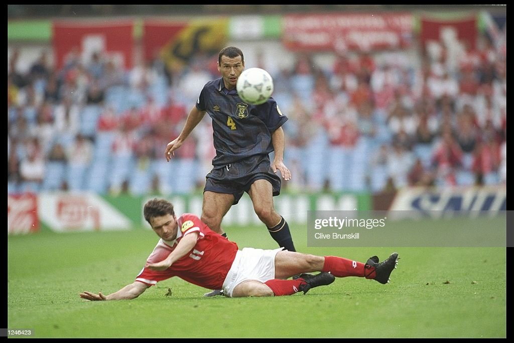 Colin Calderwood of Scotland is beaten to the ball by Stephane Chapuisat of Switzerland during the Group A match at Villa Park in the European Football Championships. Scotland beat Switzerland 1-0.
