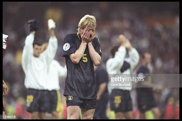 Colin Hendry of Scotland despairs as he realises Scotland are out of the European Football Championships on goal difference although Scotland beat...