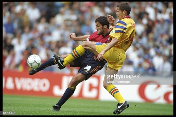 Constantin Galca of Romania is challenged by Francisco Narvaez of Spain in the Group B match in the European Football Championships played at Elland...