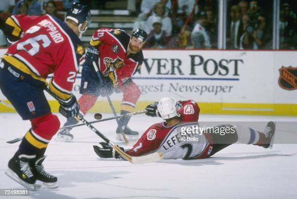 Dave Lowry of the Florida Panthers passes to teammate Ray Sheppard as Sylvain Lefebvre of the Colorado Avalanche tries to break up the pass during...