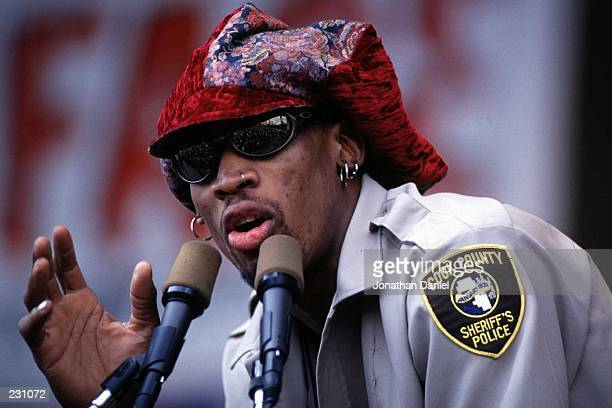 Dennis Rodman of the Chicago Bulls waves to the fans during the Bulls'' 1996 NBA Championship Victory parade in Chicago Illinois Rodman is a memeber...