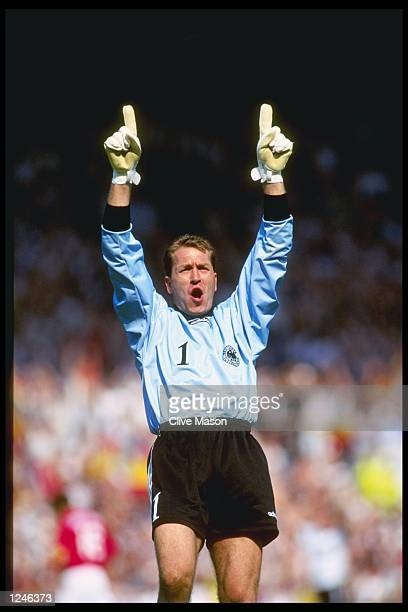 Goalkeeper Andreas Kopke of Germany celebrates as Germany beat Russia during the Group C match at Old Trafford during the European Football...