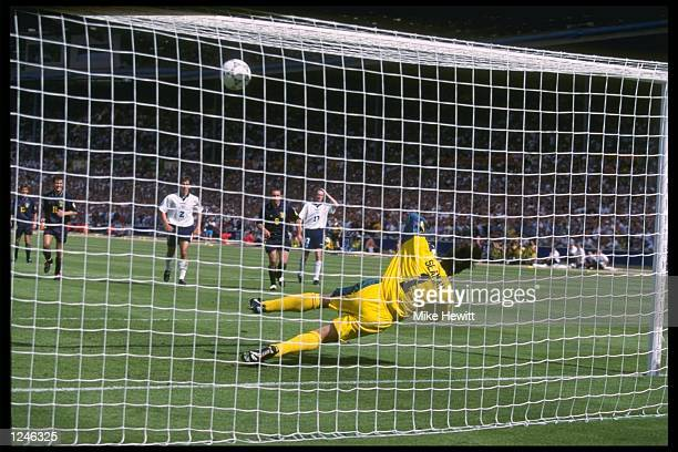 Goalkeeper David Seaman of England saves a penalty from Gary McAllister of Scotland during the England v Scotland match in Group A of the European...