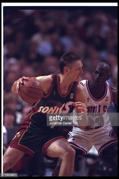 Guard Michael Jordan of the Chicago Bulls works against forward Detlef Schrempf of the Seattle SuperSonics during a game at the United Center in...