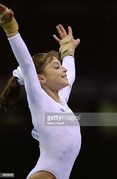 Gymnast Dominique Moceanu of the USA in the Womens Individual Competition during the 1996 Olympic Games at the Georgia Dome in Atlanta Georgia...