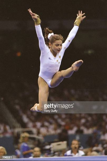 Gymnast Dominique Moceanu of the USA jumps in the Womens AllAround Competition during the 1996 Olympic Games at the Georgia Dome in Atlanta Georgia...