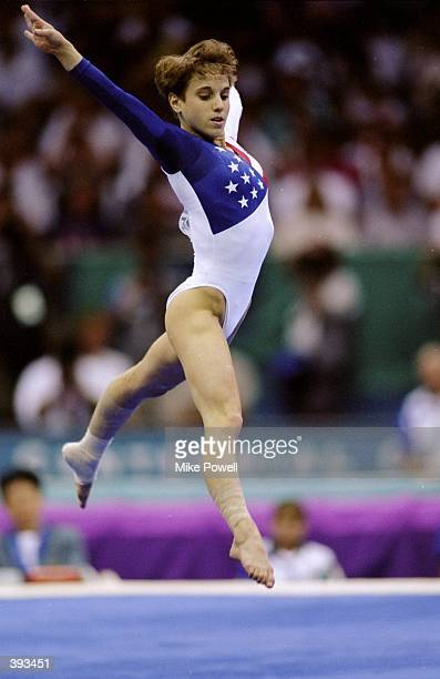 Gymnist Kerry Strug of the USA jumps in the floor exercise of the Womens Team Competition during the 1996 Olympic Games at the Georgia Dome in...