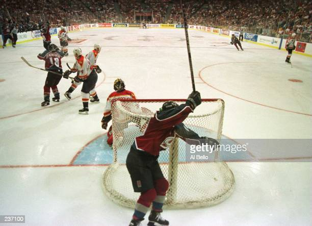 Joe Sakic captain of the Colorado Avalanche celebrates as he rounds the net after teammate Uwe Krupp scored in triple overtime to defeat the Florida...