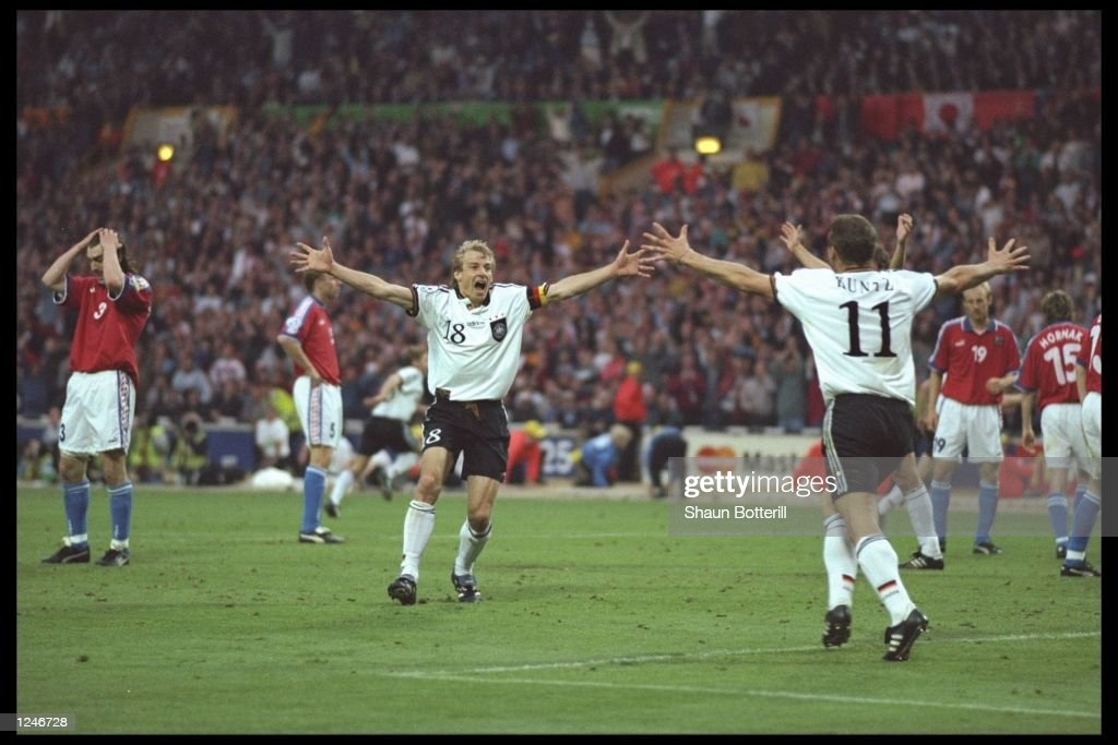 Jurgen Klinsmann (number 18) and Stefan Kuntz both of Germany, celebrate victory after the European nations soccer championship final match between the Czech Republic and Germany at Wembley Stadium, London. Germany won the final by 2-1. Mandatory Credit: Shaun Botterill/Allsport UK