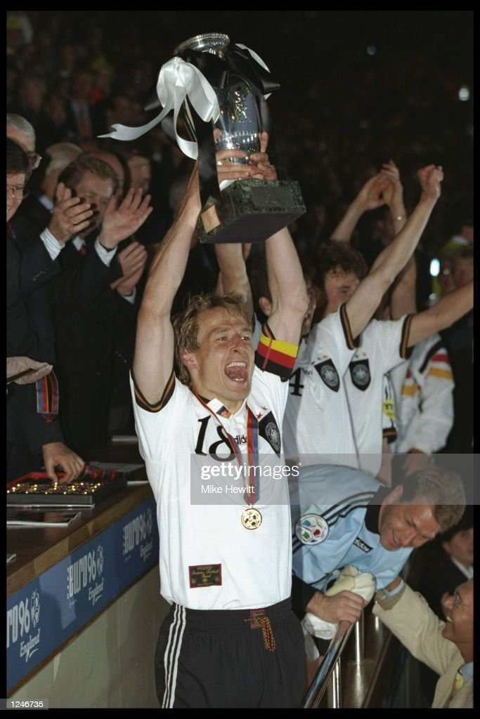 Jurgen Klinsmann of Germany holds the trophy aloft after the European nations soccer championships final match between the Czech Republic and Germany at Wembley Stadium, London. Germany won the final by 2-1. Mandatory Credit: Mike Hewitt/Allsport UK
