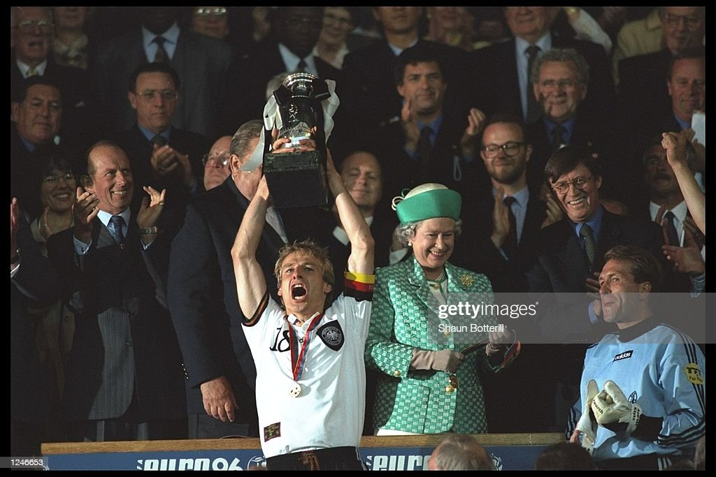 Jurgen Klinsmann of Germany lifts the European nations trophy as Germany become Champions by beating the Czech Republic by 2-1 at Wembley Stadium, London. Mandatory Credit: Shaun Botterill/Allsport UK