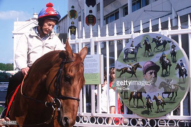 Lester Piggott rides through the new gates that have been named in his honour at Epsom racecourse Mandatory Credit Phil Cole/ALLSPORT
