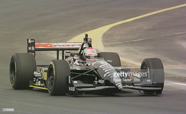 Michael Andretti drives his Lola Ford T96/00 during practice for the Miller 200 round seven of the PPG IndyCar World Series at The Milwaukee Mile in...