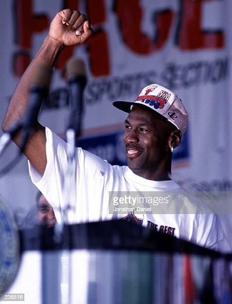Michael Jordan of the Chicago Bulls acknowledges the fans during the Bulls'' 1996 NBA Championship Victory parade in Chicago Illinois after the Bulls...