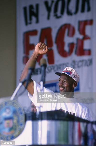Michael Jordan of the Chicago Bulls gestures to the crowd during the Bulls victory parade celebrating their 1996 NBA Championship in Chicago Illinois...