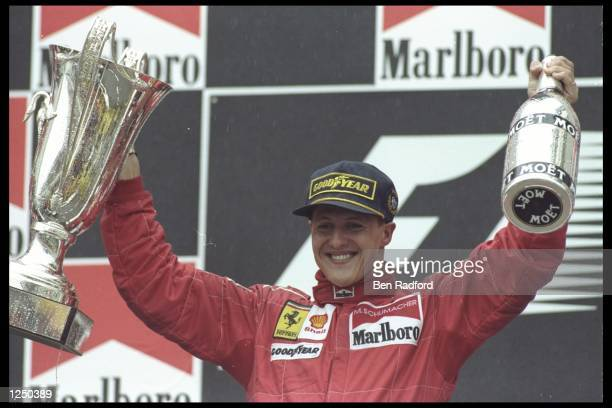 Michael Schumacher of Germany and the Ferrari team celebrates his first victory of the season during the Spanish grand prix in Barcelona Spain...