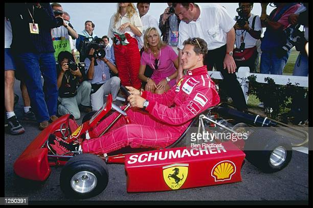 Michael Schumacher of Germany relaxes with a spot of gokarting during the French grand prix in Magny Cours France Mandatory Credit Ben...