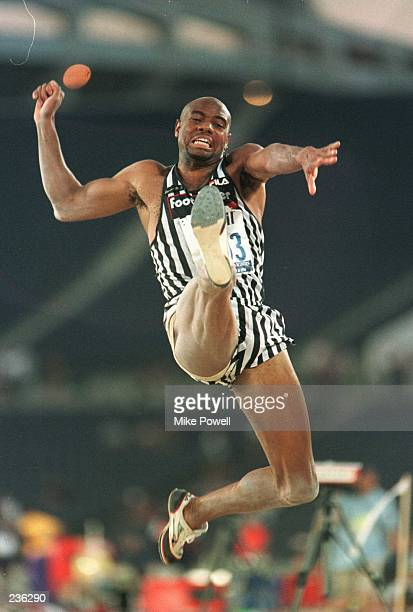 Mike Powell sails through the air during the long jump final event during the US Track Field Trials at the Olympic Stadium in Atlanta Georgia