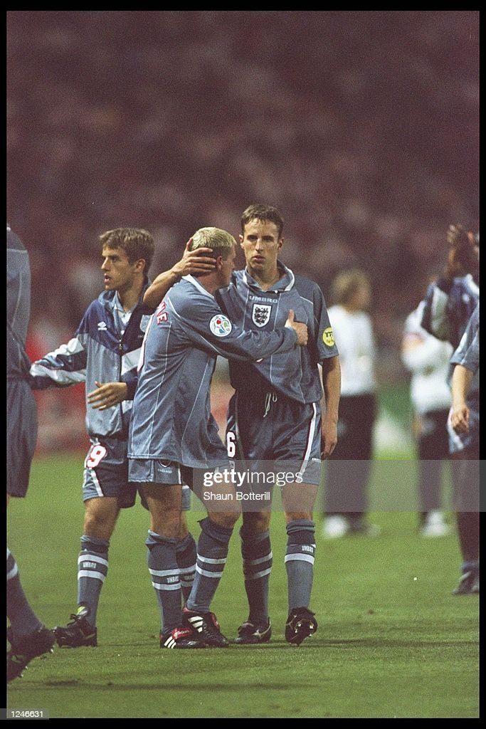 Paul Gascoigne and teammate Gareth Southgate of England show the agony of defeat during the European soccer championships semi final match between England and Germany at Wembley Stadium, London. Germany won the match after extra time in a penalty shoot out by 1(6) 1(5). Mandatory Credit: Shaun Botterill/Allsport UK
