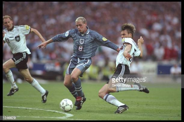 Paul Gascoigne of England is challenged by Thomas Helmer of Germany during the European championship semi final match between England and Germany at...