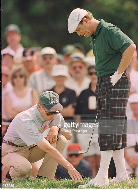 Payne Stewart gets a ruling from a USAG offcial on the seventh hole during 3rd round of the US Open at Oakland Hills Country Club in Bloomfield Hills...