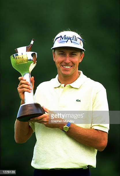 Portrait of Robert Allenby of Australia with the trophy after winning the Alamo English Open at the Forest of Arden Golf Club in Warwickshire England...