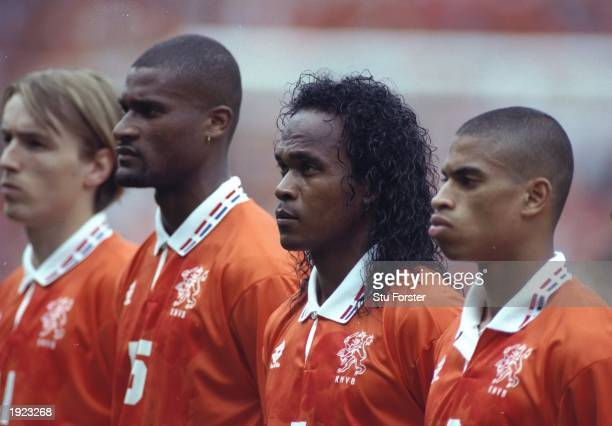 Richard Witschge Winston Bogarde Gaston Taument and Michael Reiziger all of Holland line up for the national anthems before the match against...