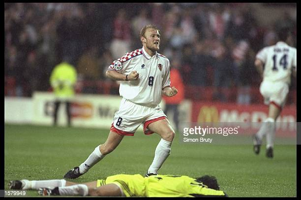 Robert Prosinecki of Croatia celebrates the Croatian winning goal during the European soccer championship match between Croatia and Turkey at the...