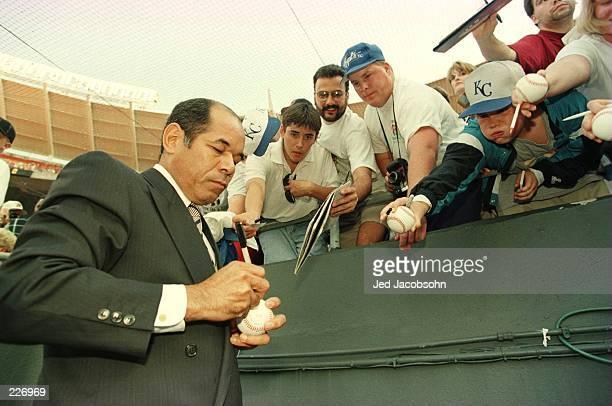 Sachio Kinugasa of Japan signs autographs before Cal Ripken Jr Baltimore Orioles broke his all time record of consecutive games played standing at...