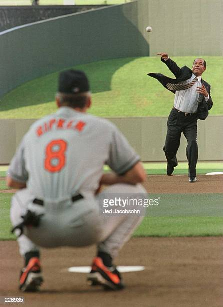 Sachio Kinugasa of japan throws the ceremonial first pitch to Cal Ripken Jr of the Baltimore Orioles to start the game against the Kansas City Royals...