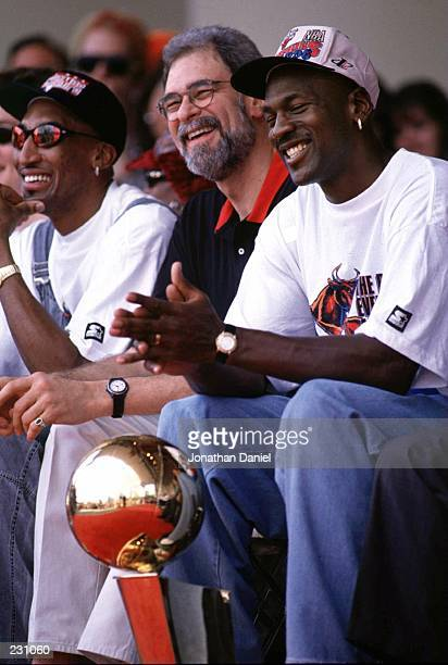 Scottie Pippen coach Phil Jackson and Michael Jordan of the Chicago Bulls share a joke during the Bulls'' 1996 NBA Championship Victory parade in...