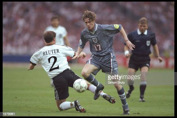 Steve McManaman of England goes round Stefan Reuter of Germany during the European soccer championships semi final match between England and Germany...