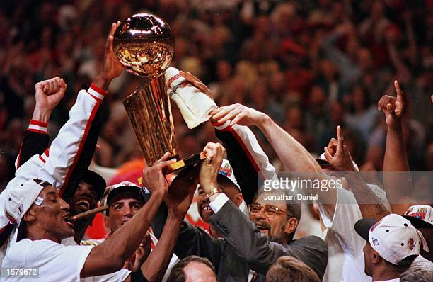 The Chicago Bulls hoist the NBA Championship trophy at the end game six of the 1996 NBA finals at the United Center in Chicago Illinois The Bulls...