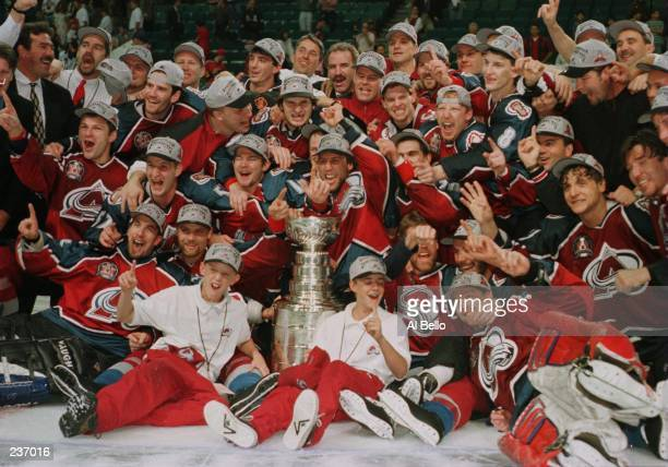 The Colorado Avalanche celebrate after winning the Stanley Cup by defeating the Florida Panthers 10 in triple overtime of game four of the Stanley...