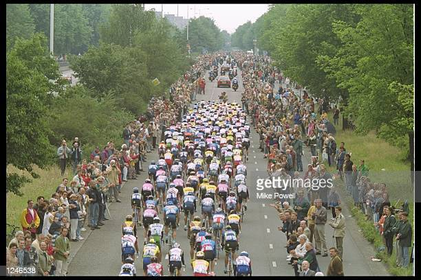The peleton flows through the the Dutch countryside during the first stage of the 83rd Tour de France The 206 kilometre stage started and finished in...