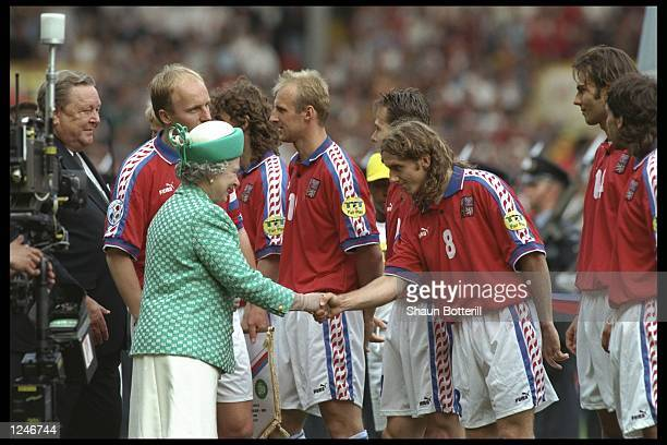 The Queen meets the Czech Republic team during the European nations soccer championships final match between the Czech Republic and Germany at...