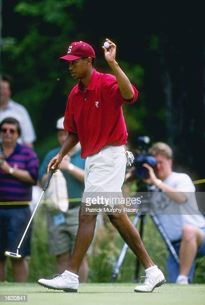 Tiger Woods of Stanford University acknowledges the gallery during his 1st place victory in the Division 1 Men's Golf Championships at Chatanooga...