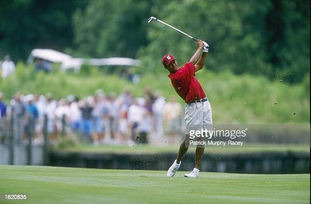 Tiger Woods of Stanford University hits a second shot off the fairway during his 1st place victory in the Division 1 Men's Golf Championships at...