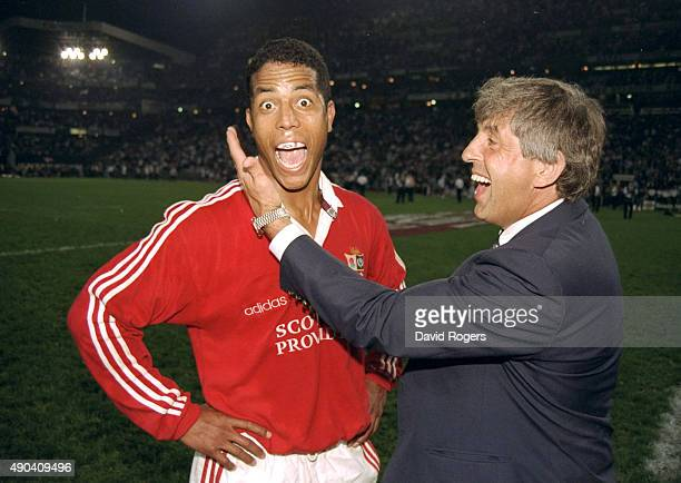 A delighted Jeremy Guscott of the British Lions is congratulated by Ian McGeechan the British Lions coach after defeating South Africa in the second...