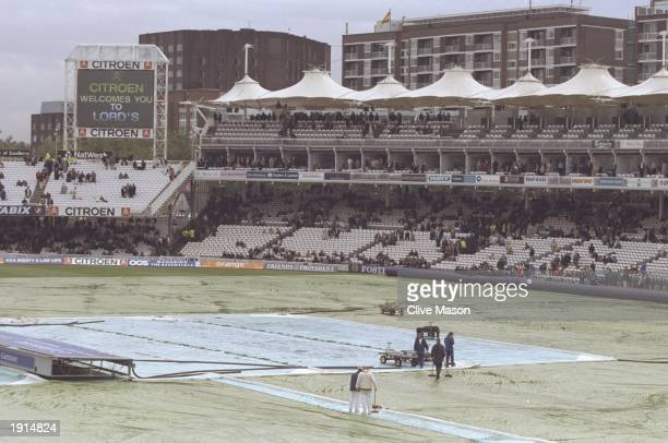 General view of the rain covers on the pitch, preventing play in the second test match between England and Australia at Lords Cricket Ground The...