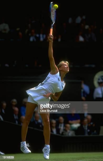 Anna Kournikova of Russia serves during her match against Chanda Rubin of the USA at the Lawn Tennis Championships at Wimbledon in London Kournikova...