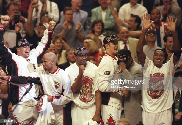 Brian Williams Ron Harper Jason Caffey Luc Longley and Scottie Pippen of the Chicago Bulls celebrate after winning game 6 of the 1997 NBA Finals at...