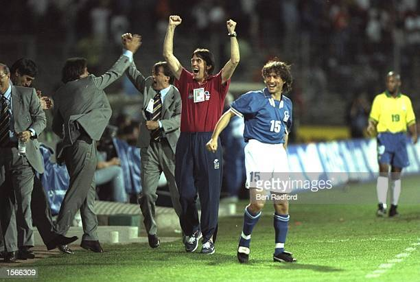 Cesare Maldini the coach of Italy celebrates a goal with Antonio Benarrivo of Italy during the match against Brazil in the Tournoi De France in Lyon...