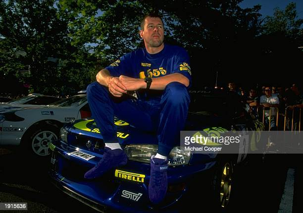 Colin McRae of Scotland sits on the bonnet of his Subaru Impreza in the Acropolis Rally during the FIA World Rally Championships in Athens Greece...