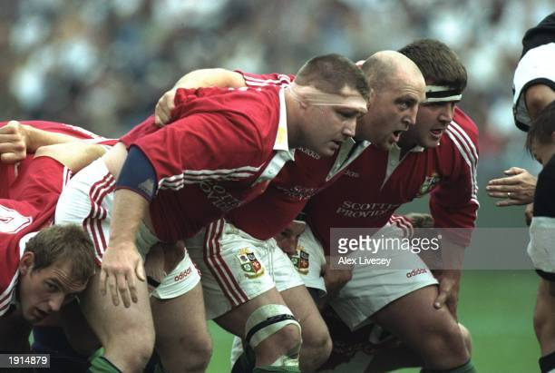 David Young Keith Wood and Tom Smith of the British Lions prepare for a scrumage during the match against Natal Sharks at Kings Park in Durban Natal...