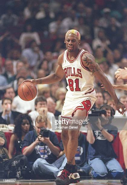 Forward Dennis Rodman of the Chicago Bulls dribbles the ball down the court during a playoff game against the Utah Jazz at the United Center in...