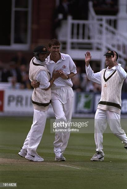 Glenn McGrath of Australia is congratulated by his team mates as he takes his eighth wicket of the innings during the second test match against...